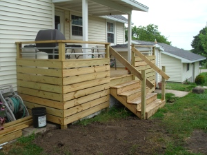 Deck! And half of the mud pit is covered! (Need more dirt!)