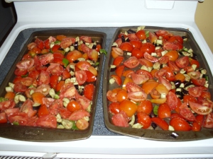2 pans of roasted tomato sauce with eggplant and peppers ready for roasting!