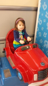 L looking extra cute at Toys'R'Ua. I got her out of here by telling her we were going to Target next--her favorite store!