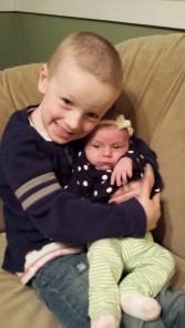 G loves on A. He is a fantastic big brother!!!