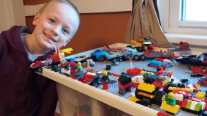 G LOVES his legos and lego table! Here he poses with his latest 'robot and transformers' creations