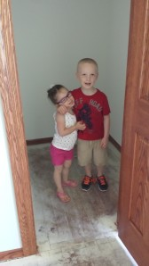G and L standing in their new walk-in closet