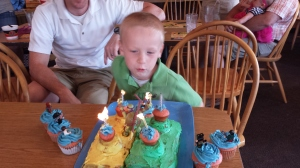 Blowing out his FIVE candles!