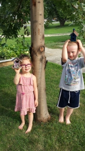 $1 birdhouses and 69 cent paint makes for 2 happy, very entertained kids for an afternoon project